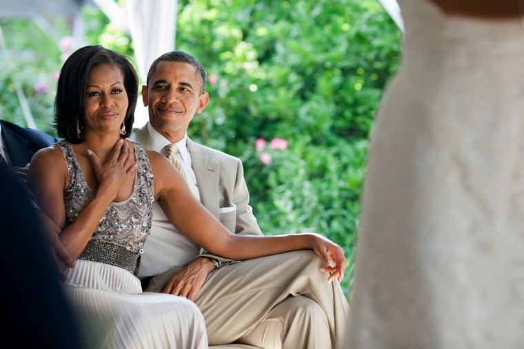 """June 18, 2012: """"The First Lady reacts as she watches Laura Jarrett and Tony Balkissoon take their vows during their wedding at Valerie Jarrett's home in Chicago."""" (Official White House Photo by Pete Souza)"""