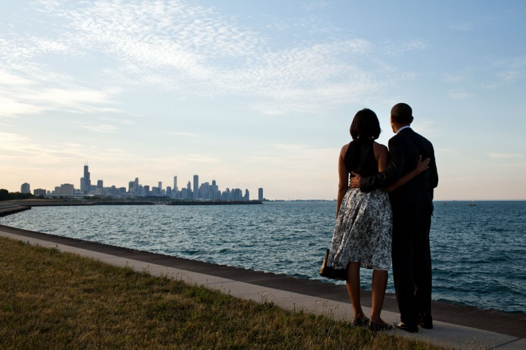"""June 15, 2012: """"We had just arrived at the helicopter landing zone in Chicago and instead of walking right to the motorcade, the President and First Lady walked past their vehicle to the edge of Lake Michigan to view the skyline of their home town."""" (Official White House Photo by Pete Souza)"""