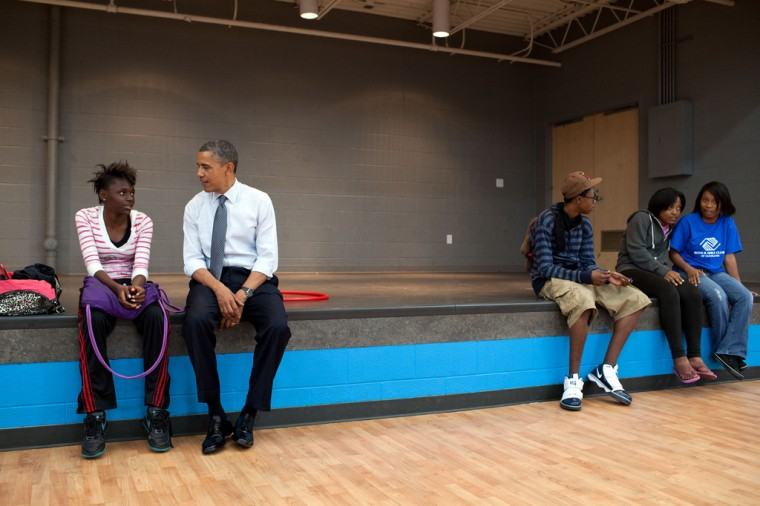 """June 14, 2012: """"We made an OTR (off-the-record, surprise stop) at the Boys and Girls Clubs of Cleveland after a campaign event, and the President sat and talked to a young woman before shooting hoops with another group of kids."""" (Official White House Photo by Pete Souza)"""