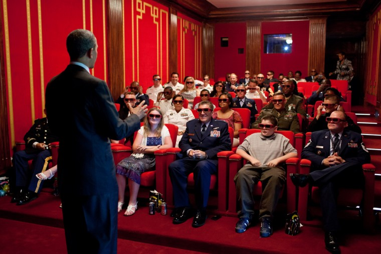 """May 25, 2012: """"The President was welcoming service members and their families to a screening of 'Men in Black 3' in the White House Family Theater. The movie was being presented in 3D, so the President jokingly asked them to try on their 3D glasses while he was speaking to them."""" (Official White House Photo by Pete Souza)"""