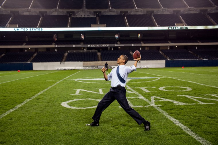 """May 20, 2012: """"'How cool is this,' the President said after he threw a football at Soldier Field following the NATO working dinner in Chicago. I think he was especially excited to be on the home turf of his beloved Chicago Bears."""" (Official White House Photo by Pete Souza)"""