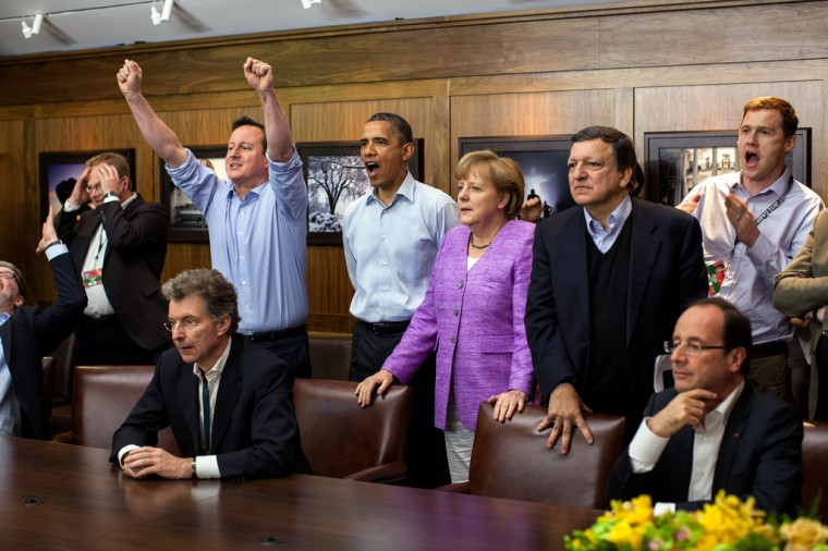 "May 19, 2012: ""At Camp David for the G8 Summit, European leaders took a break to watch the overtime shootout of the Chelsea vs. Bayern Munich Champions League final. Prime Minister David Cameron of the United Kingdom, the President, Chancellor Angela Merkel of Germany, José Manuel Barroso, President of the European Commission, French President François Hollande react during the winning goal."" (Official White House Photo by Pete Souza)"