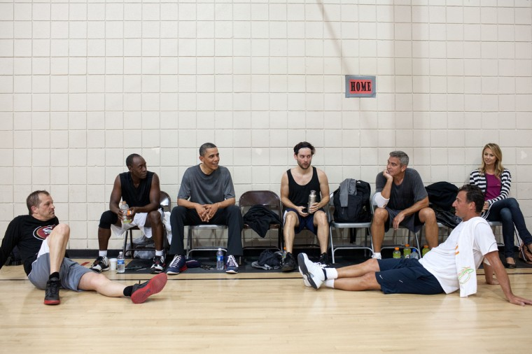 """May 11, 2012: """"After some early morning basketball in Los Angeles, the President talks with the players who included actors Don Cheadle, Tobey Maguire, and George Clooney, along with two of Clooney's long-time friends. Stacy Keibler is also at right."""" (Official White House Photo by Pete Souza)"""