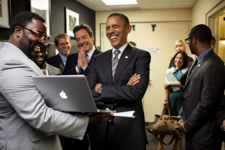 """April 24, 2012: """"We were backstage at the University of North Carolina in Chapel Hill for the President's appearance on 'Late Night with Jimmy Fallon.' The President let out a big laugh as he was being briefed by the producers and Mr. Fallon on the 'Slow Jam the News' segment."""" (Official White House Photo by Pete Souza)"""