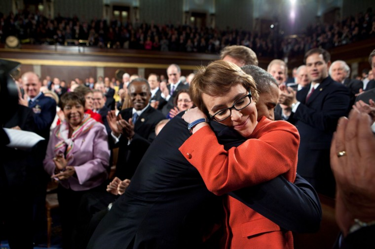 """Jan. 24, 2012: """"One of the most memorable moments of the year was when the President hugged Rep. Gabrielle Giffords as he walked onto the floor of the House Chamber at the U.S. Capitol to deliver his annual State of the Union address."""" (Official White House Photo by Pete Souza)"""