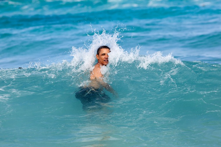 "Jan. 1, 2012: ""A nice way to celebrate the New Year for the President was to jump in the ocean in his native state of Hawaii. He was on his annual Christmas vacation with family and friends, and went swimming at Pyramid Rock Beach in Kaneohe Bay."" (Official White House Photo by Pete Souza)"