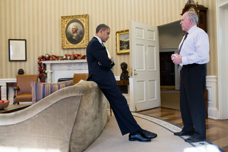 """Dec. 14, 2012: """"The President reacts as John Brennan briefs him on the details of the shootings at Sandy Hook Elementary School in Newtown, Conn. The President later said during a TV interview that this was the worst day of his Presidency."""" (Official White House Photo by Pete Souza)"""