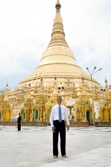 """Nov. 19, 2012: """"To some, this is just a snapshot and doesn't belong in this gallery of candid photographs from the year. But to me, it evokes what the trip to Burma was all about. Here is the President, shoes and socks off in respect, posing like an American tourist in front of the oldest pagoda in the world in a country that no U.S. President had ever been able to visit."""" 