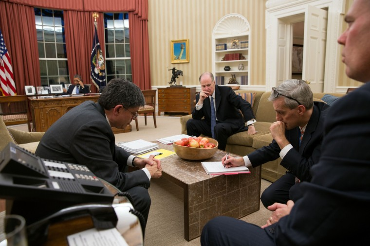 """Nov. 14, 2012: """"Aides listen on the speaker phone in the Oval Office as the President talks on the phone with President Mohammed Morsi of Egypt about the escalating violence in Gaza."""" (Official White House Photo by Pete Souza)"""