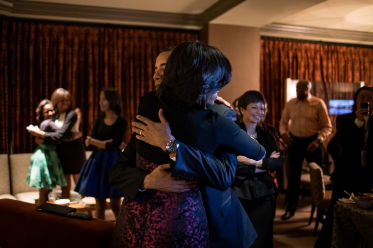 """Nov. 6, 2012 (Election Day): """"The Obama family and close friends were watching election results at a Chicago hotel. The President had warned everyone that it could be a very late night. Yet, only a few minutes later, the networks projected that he had been re-elected, and the President embraced the First Lady, while in the background, daughter Sasha hugged one of her cousins."""" (Official White House Photo by Pete Souza)"""