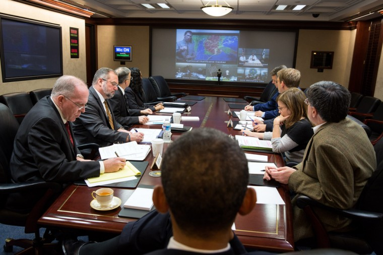 """Oct. 29, 2012: """"In the White House Situation Room, the President receives an update to the ongoing response to Hurricane Sandy during a teleconference with key officials."""" (Official White House Photo by Pete Souza)"""