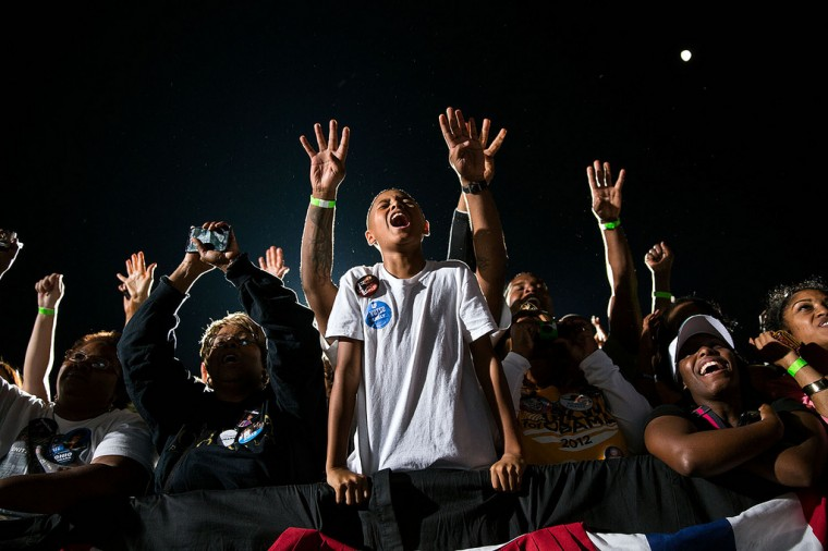 """Oct. 25, 2012: """"At a late night rally in Cleveland, supporters react as the President delivered his remarks."""" (Official White House Photo by Pete Souza)"""