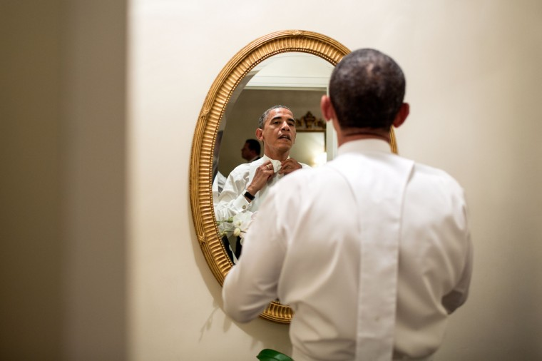 """Oct. 18, 2012: """"The President ties his white tie before the Alfred E. Smith dinner in New York. Although the dinner is an annual event, every four years, the two presidential nominees attend the dinner only a few weeks before the election."""" (Official White House Photo by Pete Souza)"""