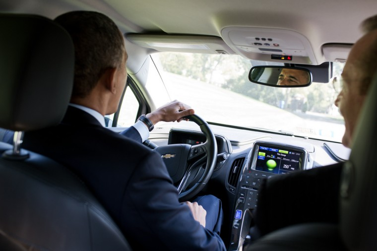 """Oct. 12, 2012: """"The President had invited former White House Press Secretary Robert Gibbs to have lunch, and they apparently started talking about Gibb's Chevy Volt. Gibbs knew the President had visited one of their factories and was hoping to drive a Volt one day. Gibbs told the President that his car was on the South Drive. So the President jumped in and made three loops around the drive, joking later that the Secret Service ordered that the White House gates not be opened under any circumstances."""" (Official White House Photo by Pete Souza)"""