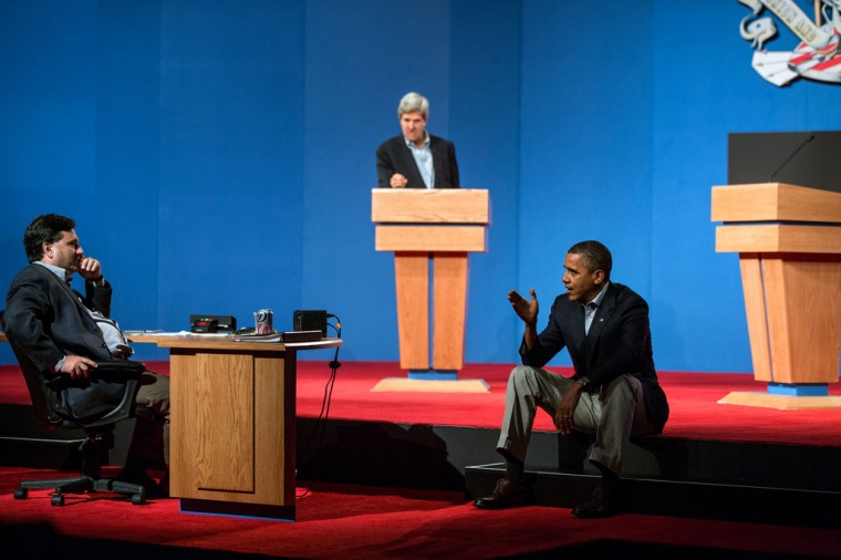 """Oct. 2, 2012: """"The President talks with Ron Klain during debate preparations in Henderson, Nev. Sen. John Kerry, D-Mass., background, played the role of Gov. Mitt Romney during the prep sessions."""" (Official White House Photo by Pete Souza)"""