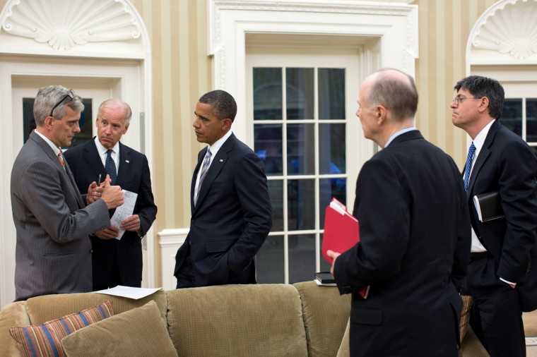 """Sept. 11, 2012: """"Denis McDonough, Deputy National Security Advisor, left, updates the President and Vice President on the situation in the Middle East and North Africa. National Security Advisor Tom Donilon and Chief of Staff Jack Lew are at right."""" (Official White House Photo by Pete Souza)"""