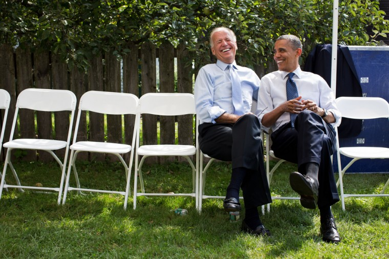 """Sept. 7, 2012: """"The President and Vice President share a laugh before a campaign rally together in Portsmouth, N.H."""" (Official White House Photo by Pete Souza)"""