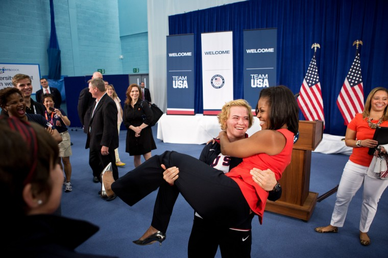 """July 27, 2012: """"Sonya Hebert captured this amusing moment as U.S. Olympic wrestler Elena Pirozhkova literally picked up the First Lady during a greet with Team USA Olympic athletes competing in the 2012 Summer Olympic Games in London."""" (Official White House Photo by Sonya N. Hebert)"""