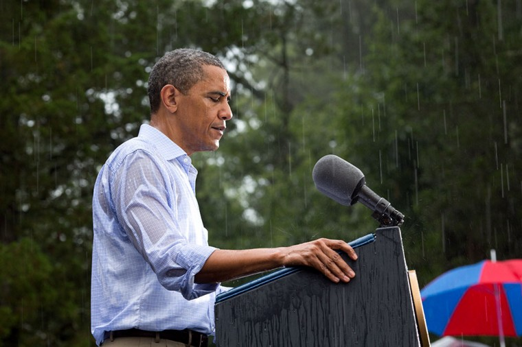 "July 14, 2012: ""The President delivers remarks in the pouring rain at a campaign event in Glen Allen, Va. He was supposed to do a series of press interviews inside before his speech, but since people had been waiting for hours in the rain he did his remarks as soon as he arrived at the site so people could go home to dry off ."" (Official White House Photo by Pete Souza)"