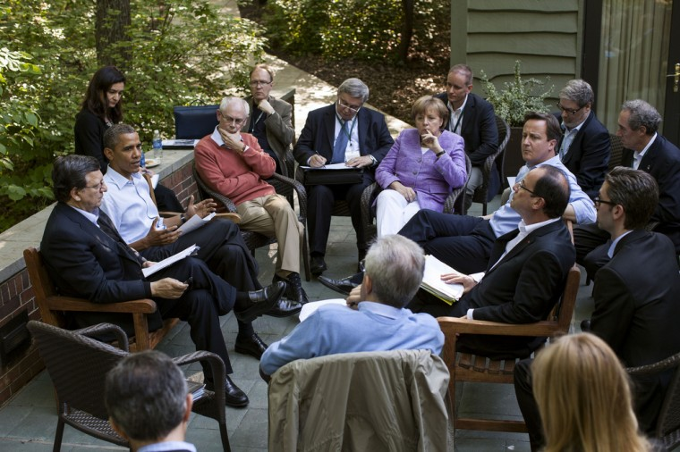 """May 19, 2012: """"One of the great things about the G8 Summit being at Camp David was the relaxed and casual atmosphere. When the President decided to have an unscheduled meeting with just the Eurozone leaders, he asked them to step outside on the Laurel Cabin patio where the leaders and their staff all pulled up chairs for the impromptu meeting."""" (Official White House Photo by Pete Souza)"""