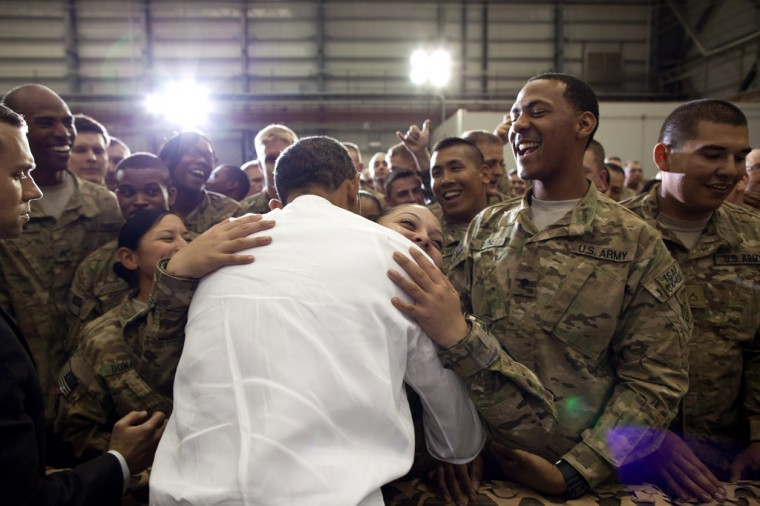 "May 1, 2012: ""A soldier hugs the President as he greeted U.S. troops at Bagram Air Field in Afghanistan."" (Official White House Photo by Pete Souza)"