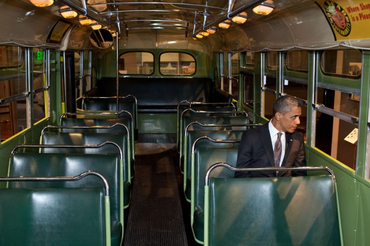 """April 18, 2012: """"We were doing an event at the Henry Ford Museum in Dearborn, Mich. Before speaking, the President was looking at some of the automobiles and exhibits adjacent to the event, and before I knew what was happening he walked onto the famed Rosa Parks bus. He sat in one of the seats, looking out the window for only a few seconds."""" (Official White House Photo by Pete Souza)"""