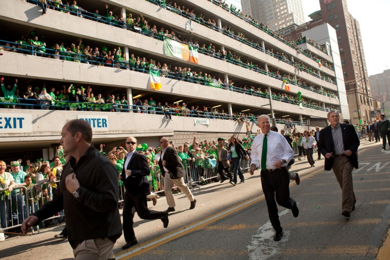 """March 17, 2012: """"David Lienemann made this action photograph of Vice President Joe Biden and his security detail literally running during the St. Patrick's Day Parade in Pittsburgh, Pa."""" (Official White House Photo by David Lienemann)"""