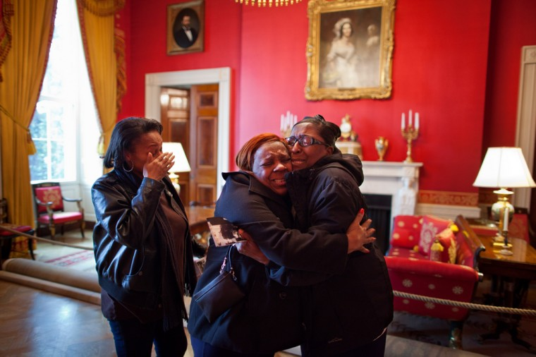 "Feb. 16, 2012: ""Chuck Kennedy made this photograph of women reacting in the Red Room after being surprised by First Lady Michelle Obama during their White House tour."" (Official White House Photo by Chuck Kennedy)"