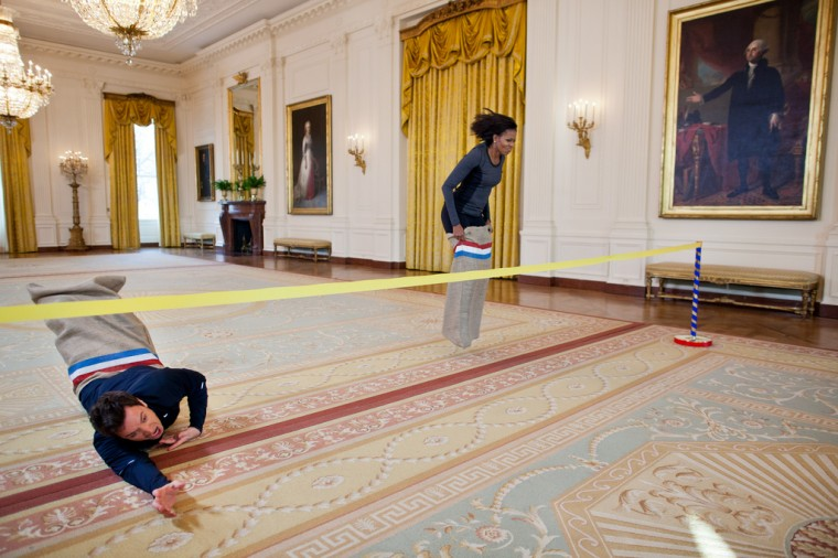 """Jan. 25, 2012: """"Chuck Kennedy made this amusing photograph of First Lady Michelle Obama participating in a potato sack race with Jimmy Fallon in the East Room of the White House during a """"Late Night with Jimmy Fallon"""" taping for the second anniversary of the """"Let's Move!"""" initiative."""" (Official White House Photo by Chuck Kennedy)"""