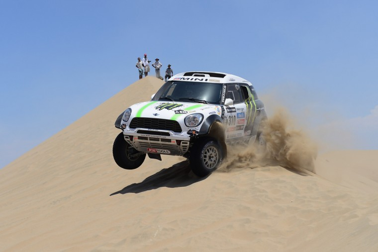Krysztof Holowczyc and co-pilot Filipe Palmeiro of team Mini compete during the stage from Pisco to Pisco on day two of the 2013 Dakar Rally on January 6, 2013 in Pisco, Peru. (Shaun Botterill/Getty Images)