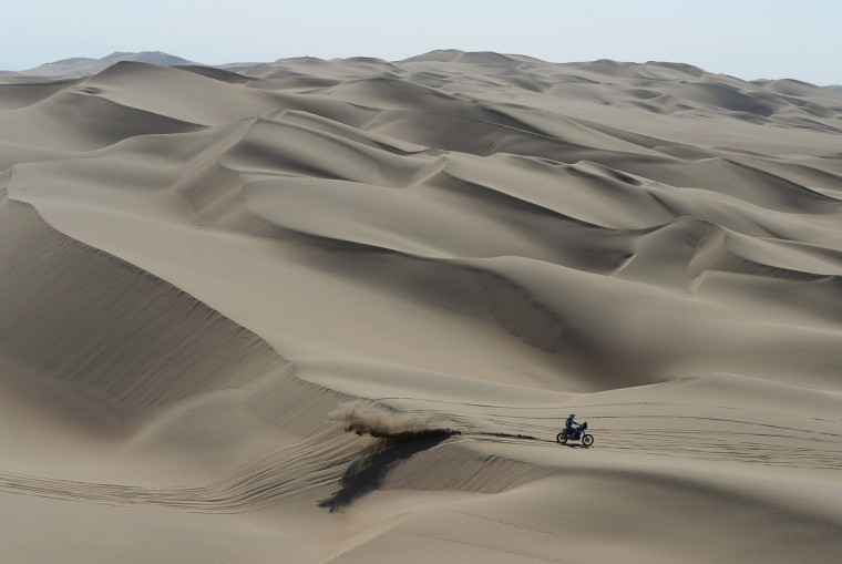 A Rider crosses the dunes during the stage from Pisco to Nazca on day three of the 2013 Dakar Rally on January 7, 2013 in Pisco, Peru. (Shaun Botterill/Getty Images)