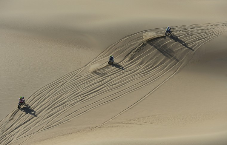Riders cross the dunes during the stage from Pisco to Nazca on day three of the 2013 Dakar Rally on January 7, 2013 in Pisco, Peru. (Shaun Botterill/Getty Images)