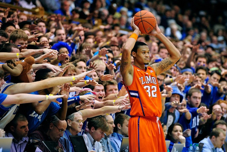 The Cameron Crazies taunt K.J. McDaniels #32 of the Clemson Tigers as he prepares to inbound the ball against the Duke Blue Devils during play at Cameron Indoor Stadium in Durham, North Carolina. Duke won 68-40. (Grant Halverson/Getty Images)