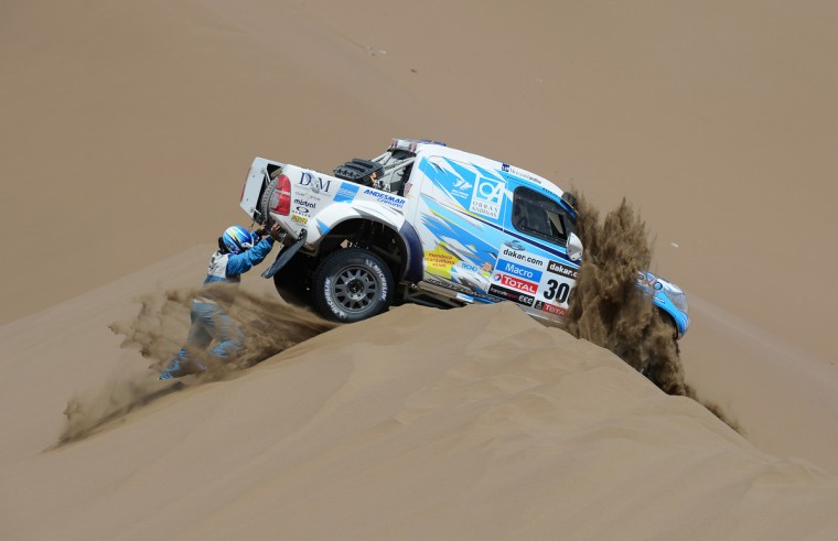 Lucio Alvarez and co-driver Ronnie Graue of team Toyota try to move their stranded car during stage 6 from Arica to Calama during the 2013 Dakar Rally on January 10, 2013 in Arica, Chile. (Shaun Botterill/Getty Images)
