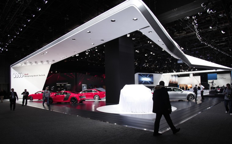 People visit the Audi exhibit at the 2013 North American International Auto Show media preview at the Cobo Center in Detroit, Michigan. Approximately 6,000 members of the media from 68 countries are attending the show this year. The 2013 NAIAS opens to the public January 19th. (Bill Pugliano/Getty Images)