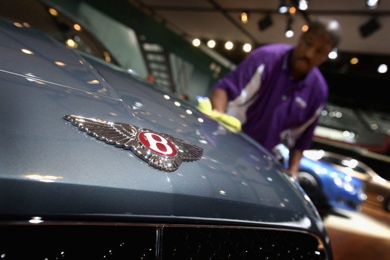 Carlos Bryant polishes a Bentley GTV8 during the media preview at the North American International Auto Show in Detroit, Michigan. (Scott Olson/Getty Images)