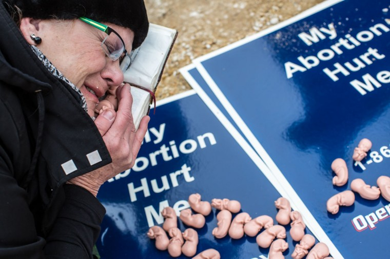 Anti-abortion protestor Sharon Turner from Sun Lakes, Arizona, prays before the March for Life in Washington, DC. The pro-life gathering is held each year around the anniversary of the Roe v. Wade Supreme Court decision. (Brendan Hoffman/Getty Images)
