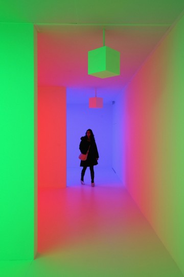 A woman admires an art installation by Carlos Cruz-Diez entitled 'Chromosaturation' which features in the Hayward Gallery's exhibition 'Light Show' in London, England. 'Light Show' features 25 illuminated installations and sculptures by major international artists from the 1960s to the present day. The show opens to the general public on January 30, 2013 and runs until April 28, 2013. (Oli Scarff/Getty Images)