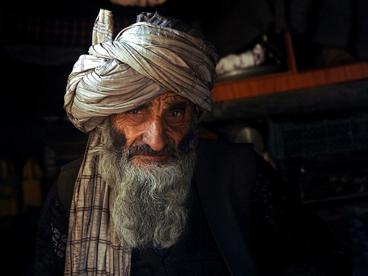 An Afghan man looks on for a portrait at a refugee camp in Herat. Hundreds of families living in makeshift shelters around the Afghan capital Kabul collected blankets, charcoal and other supplies on January 2 as authorities struggle to avoid last year's deadly winter toll. With temperatures dropping to -10 Celsius (14 Fahrenheit) at night in the city, the 35,000 refugees who live in the snow-covered camps face a battle to survive dire conditions protected only by plastic sheeting. (Aref Karimi/Getty Images)