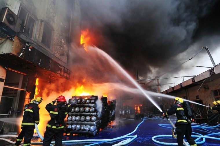 Firefighters work to put out a fire at a fur factory that contains six tanks of hazardous chemicals in Wenzhou, in eastern China's Zhejiang province. More than 350 firefighters were brought in to get the fire under control, while no deaths were reported yet. (Getty Images)