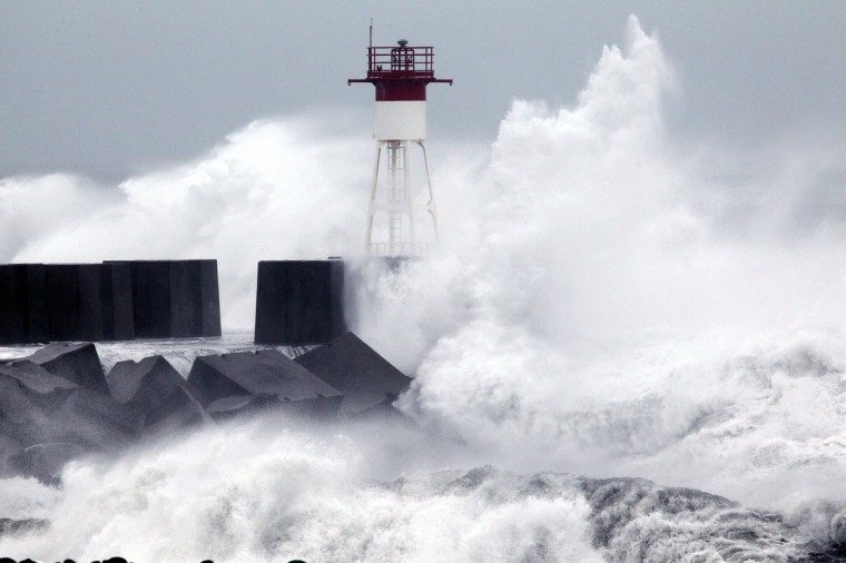 High waves hit the coastline in Le Port, western part of French overseas' island of La Reunion, as cyclone Dumile approaches and authorities declare today a red alert that forbid people to leave their homes. (Richard Bouhet/Getty Images)