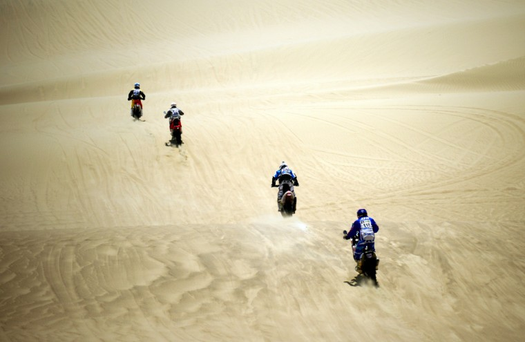 Riders compete during the Stage 1 of the Dakar 2013 between Lima and Pisco, Peru, on January 5, 2013. The rally will take place in Peru, Argentina and Chile from January 5 to 20. (Franck Fife/Getty Images)