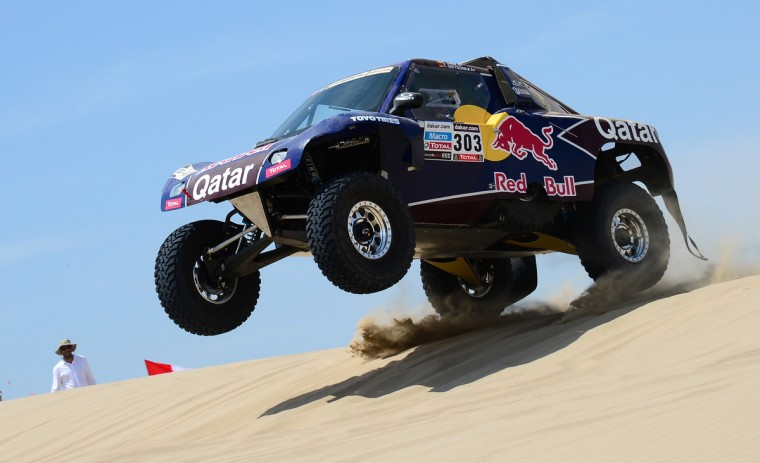 Spain's Carlos Sainz steers his Buggy during the Stage 1 of the Dakar 2013 between Lima and Pisco, Peru, on January 5, 2013. (Franck Fife/Getty Images)