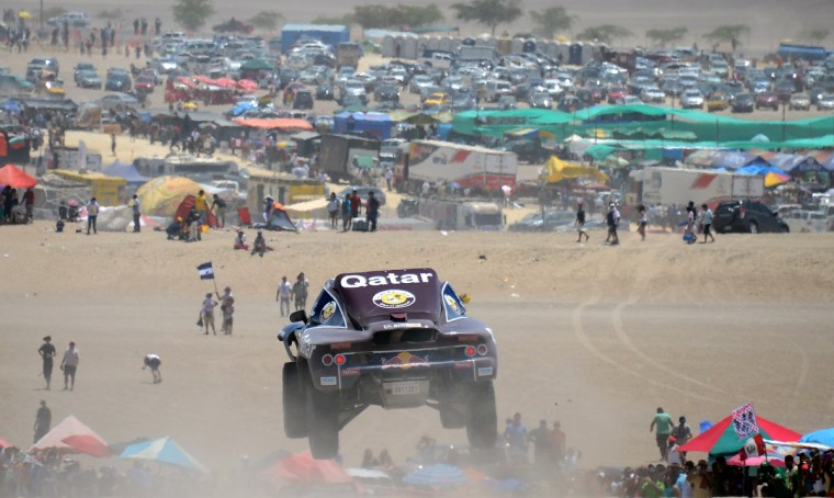 Qatar's Nasser Al-Attiyah competes during the Stage 2 of the Dakar 2013 between Pisco and Pisco, Peru, on January 6, 2013. The rally will take place in Peru, Argentina and Chile from January 5 to 20. A(Franck Fife/Getty Images)