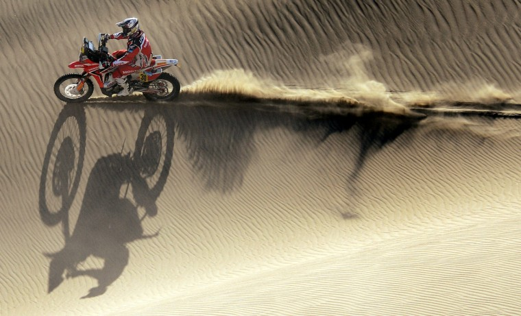 Honda's biker Javier Pizzolito of Argentina competes during the Stage 2 of the Dakar 2013 in Pisco, Peru, on January 6, 2013. The rally will take place in Peru, Argentina and Chile from January 5 to 20. (Franck Fife/Getty Images)