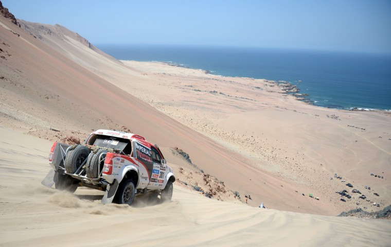Toyota's driver Giniel De Villiers of South Africa competes during Stage 3 of the Dakar Rally 2013 between Pisco and Nazca, Peru, on January 7, 2013. (Franck Fife/Getty Images)