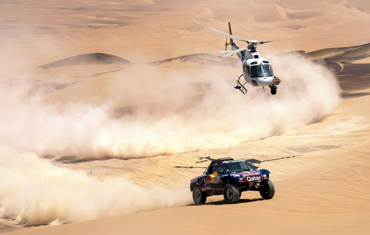 Qatar's Nasser Al-Attiyah competes during Stage 3 of the Dakar Rally 2013 between Pisco and Nazca, Peru, on January 7, 2013. (Franck Fife/Getty Images)