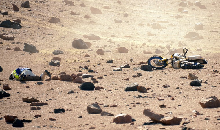 The Netherlands´ Henno Van Bergeijk is seen on the ground after falling during Stage 3 of the Dakar Rally 2013 between Pisco and Nazca, Peru, on January 7, 2013. (Franck Fife/Getty Images)