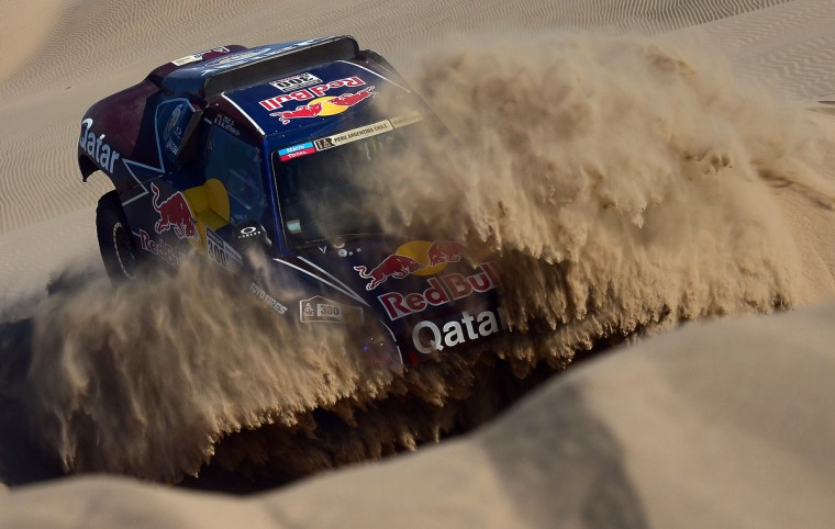 Qatar's Nasser Al-Attiyah competes during Stage 4 of the Dakar 2013 between Nazca and Arequipa, Peru, on January 8, 2013. (Franck Fife/Getty Images)