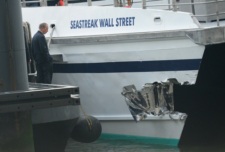 "New York Mayor Michael Bloomberg inspects the damage after the commuter ferry slammed into a pier in New York. About 50 people were injured when a rush-hour ferry packed with commuters smashed into a pier in New York City on Wednesday, firefighters said. The accident took place at 8:45 am (1345 GMT) on Pier 11 in the East River in lower Manhattan, not far from Wall Street, the New York Fire Department said. The ferry was arriving from New Jersey. ""We are assessing 50 patients on the scene right now. We don't know what kind of injuries they have,"" an NYFD spokeswoman said. (Emmanuel Dunand/Getty Images)"